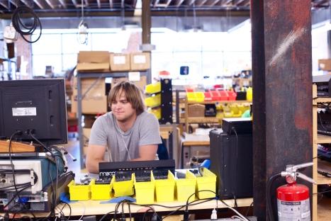 Smiling_moog_worker,_Moog_Music_factory